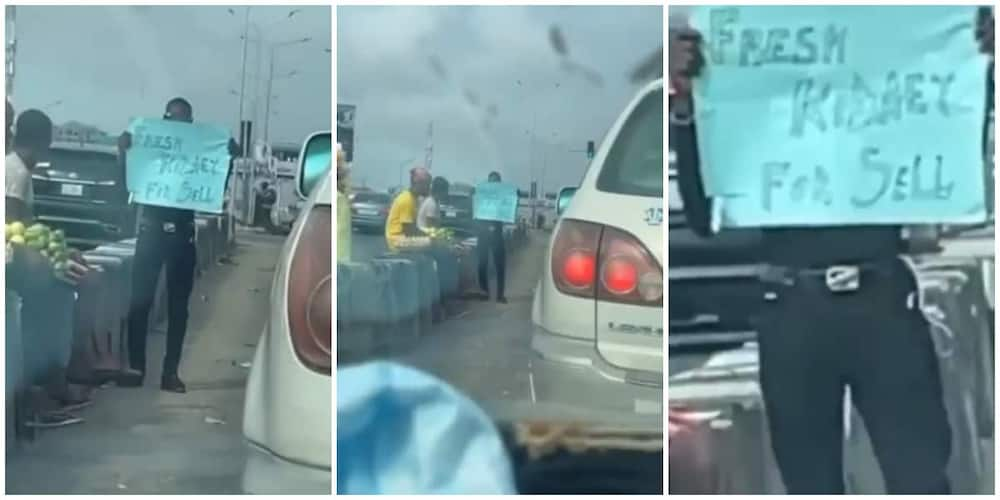 Reactions as Nigerian man hits busy road with cardboard as he puts his kidney up for sale