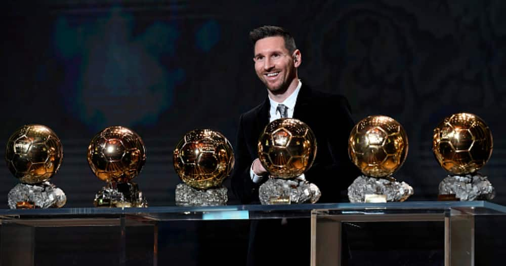 Lionel Messi poses onstage after winning his sixth Ballon D'Or award at Theatre Du Chatelet in December 2019. Photo by Kristy Sparow/Getty Images.