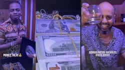 Diamond Platnumz Shows Off Stacks of Cash, Gold Jewellery While Chilling With Manager Sallam