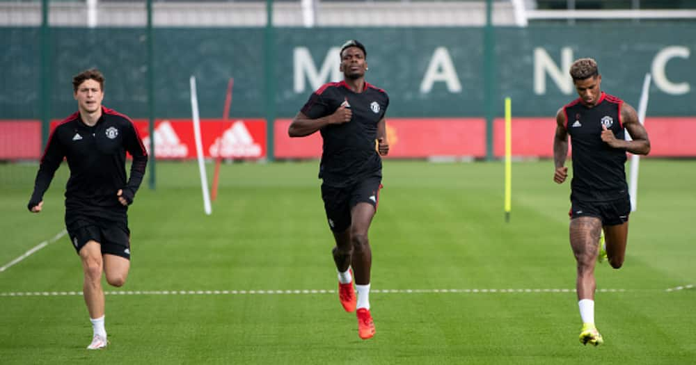 Victor Lindelof, Paul Pogba, Marcus Rashford of Manchester United in action during a first-team training session at Carrington Training Ground on September 16, 2021 in Manchester, England. (Photo by Ash Donelon/Manchester United via Getty Images)