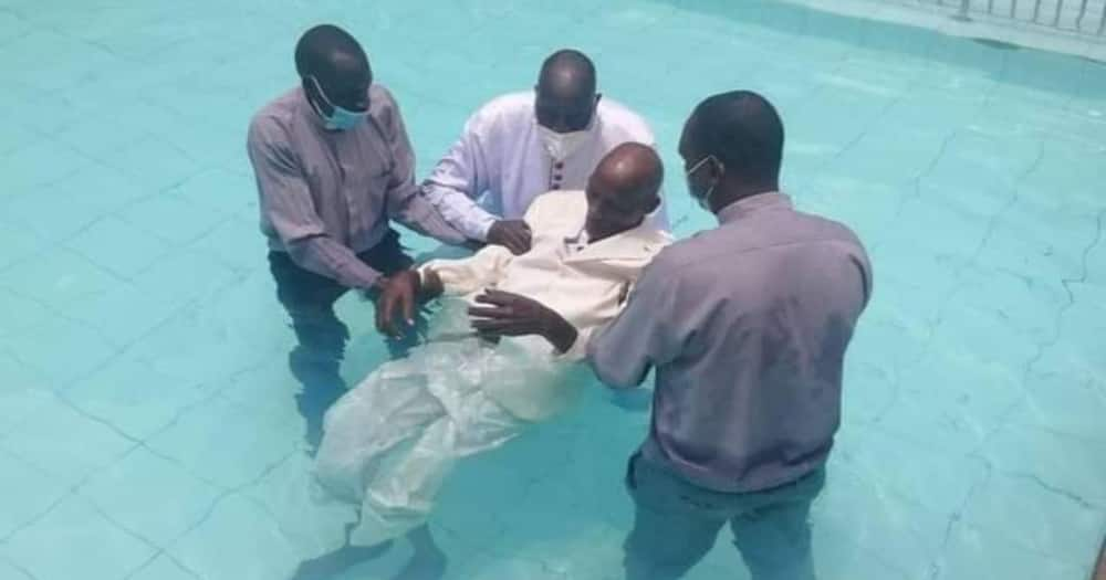 The baptism took place at the Boma Inn's swimming pool on Monday, May 3. Photo: Bernard Kemei.
