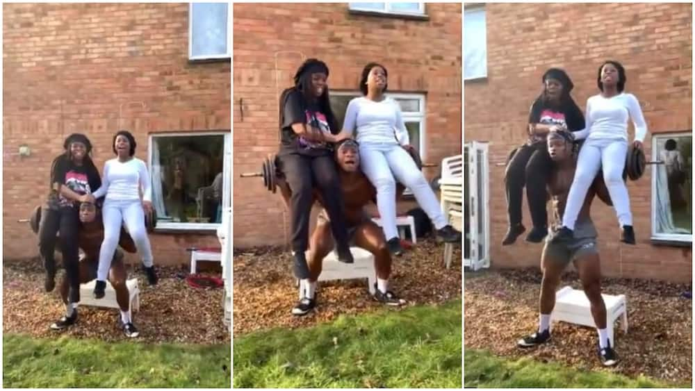 Young man carries 2 sisters on heavyweight bar as they dance on his shoulder, video goes viral