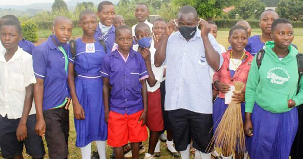 Deogratius Sanyu with his former classmates.