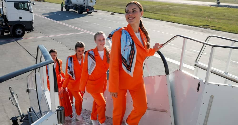Female flight attendants can now rock trouser suits and sneakers.