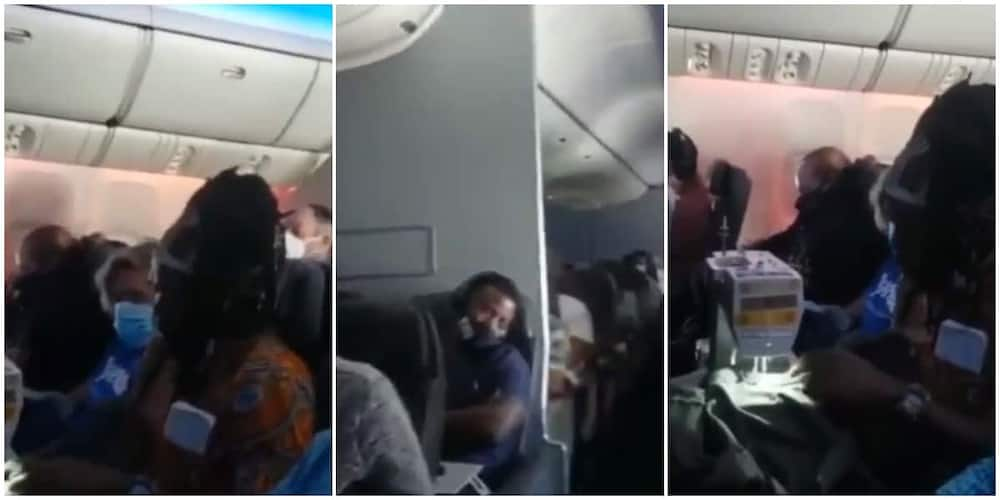 A man was seen sewing clothes on a plane