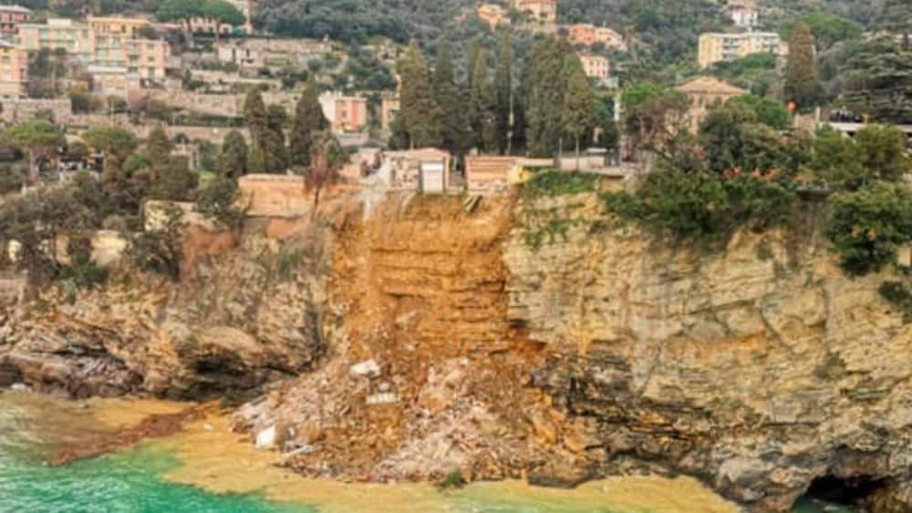 Hundreds of coffins fall into the sea after landslide causes collapse of cemetery