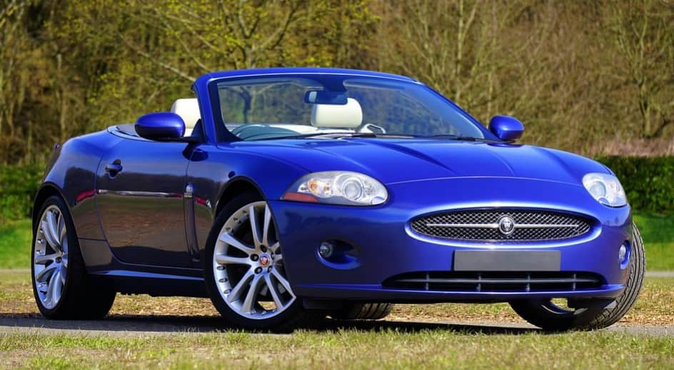 Who owns Land Rover and Jaguar car company?