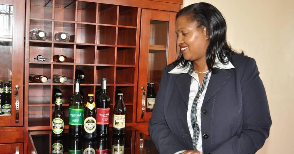 Tabitha Karanja displays some of the beer brands made by Keroche Breweries.