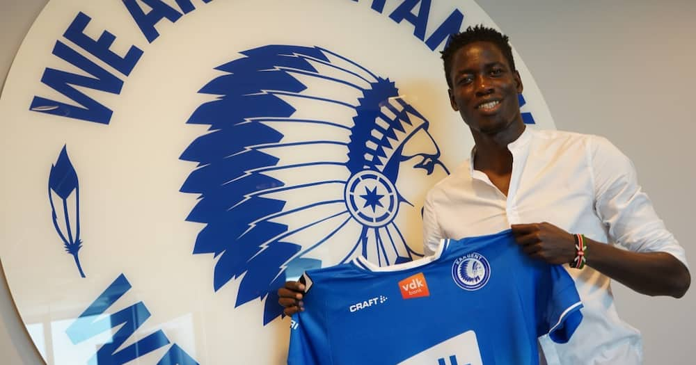 Joseph Okumu poses with a Gent shirt after sealing a transfer to the Belgian club in June 2021. Photo: Twitter.