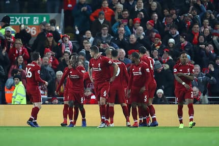Red-hot Liverpool hammers Man United 3-1 at Anfield to return to the summit of the league table