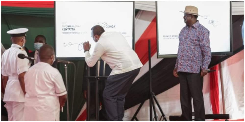 President Uhuru Kenyatta and ODM leader Raila Odinga during the launch of the BBI signature collection exercise at KICC in Nairobi on November 25, 2020. Photo: State House.