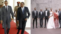 President Paul Kagame emerges the shortest member of his family while posing in daughter's wedding photo