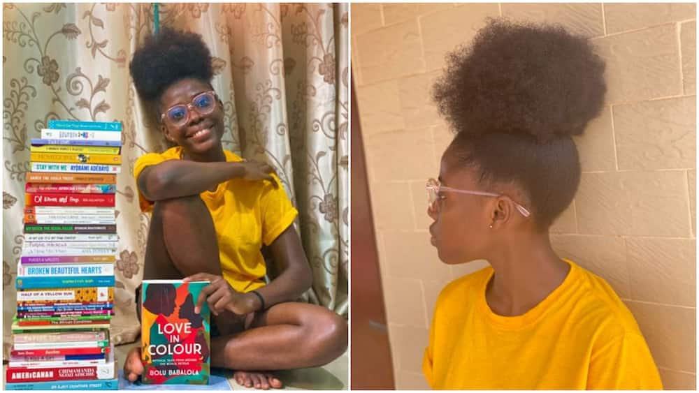 Beautiful Nigerian lady poses with books she read in 2020, photos go viral