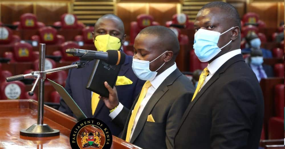UDA MPs Kimani Ichungwa'h and Ndindi Nyoro flank Kiambaa MP John Njuguna during the swearing-in ceremony.