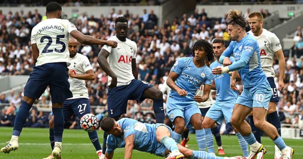 Ruben Dias of Manchester City wins a header during the Premier League match between Tottenham Hotspur and Manchester City at Tottenham Hotspur Stadium on August 15, 2021 in London, England. (Photo by Shaun Botterill/Getty Images)