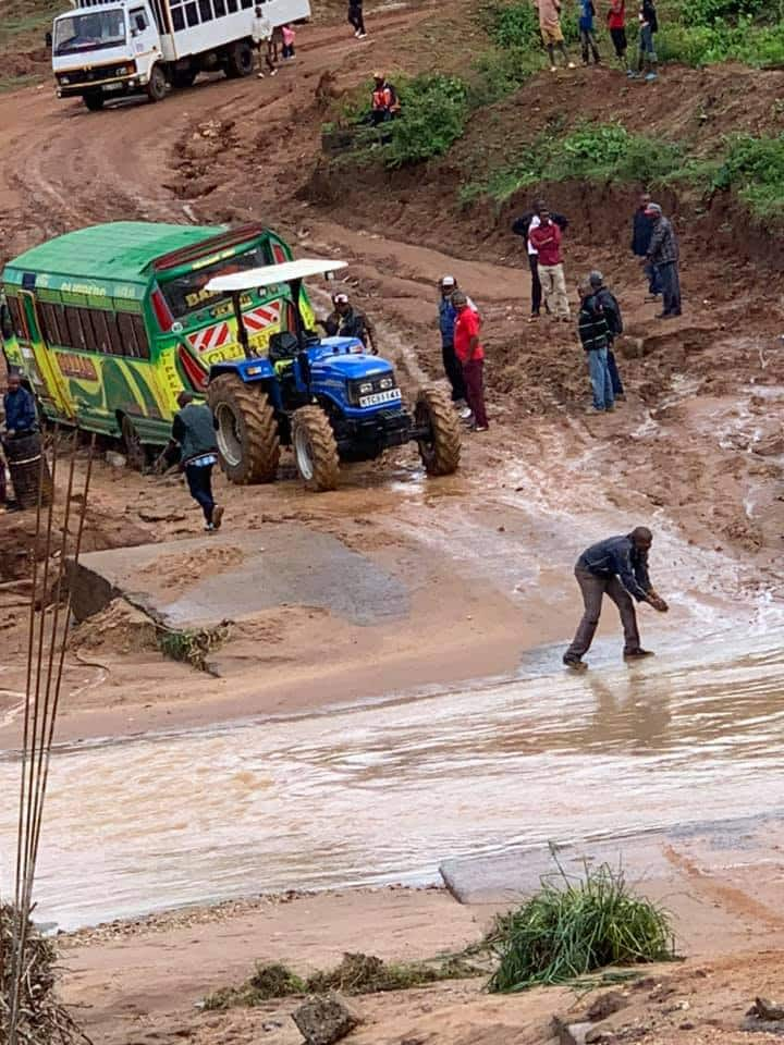 Nyeri county woman rep Rahab Mukami forced to cross flooded road on foot