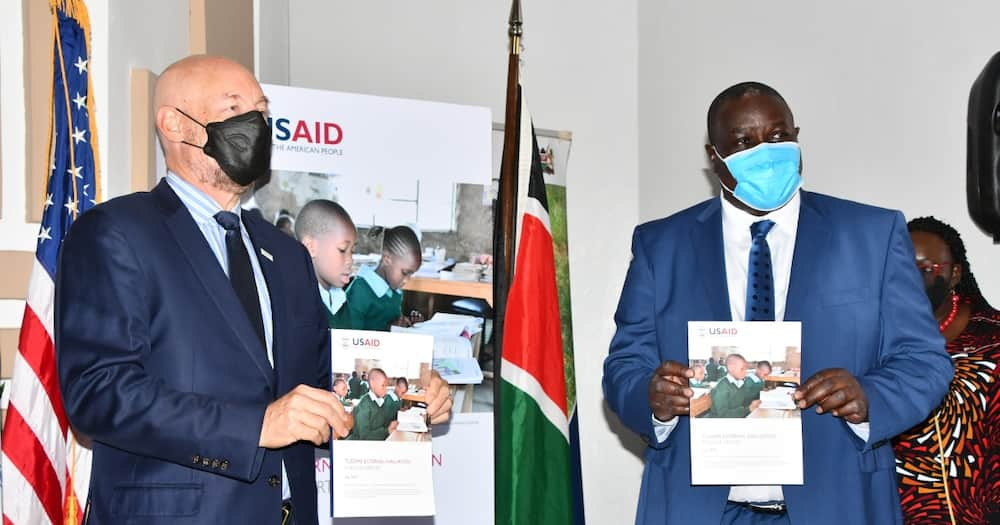 Basic Education PS Julius Jwan (right) with Mark Andrew Meassick, mission director, USAID Kenya.