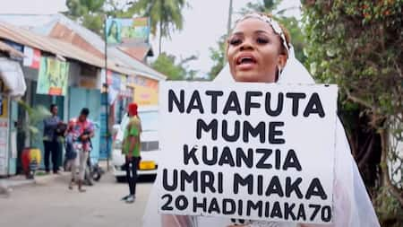 """Woman Takes to the Streets Wearing Wedding Gown, Rings Looking for Hubby: """"Umri Umekwenda"""""""