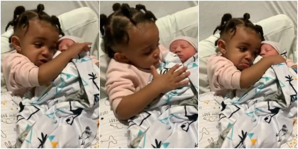 The little girl is seeing her baby brother for the first time
