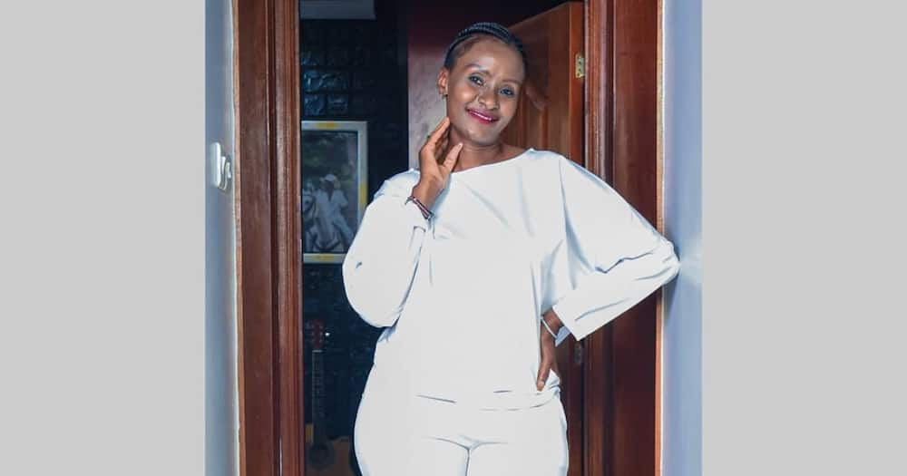 Esther Musila shows off her face in makeup.