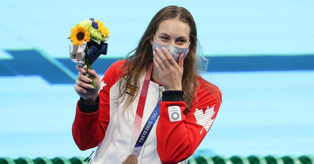 Penny Oleksiak for Canada.