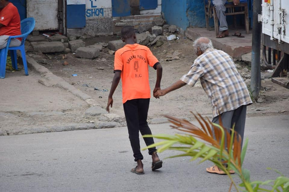 Mombasa boy warms hearts after putting bicycle aside to help elderly man cross road