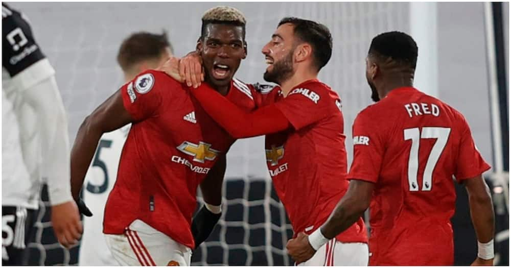 Pogba celebrates with teammates during a match. Photo: Getty Images.