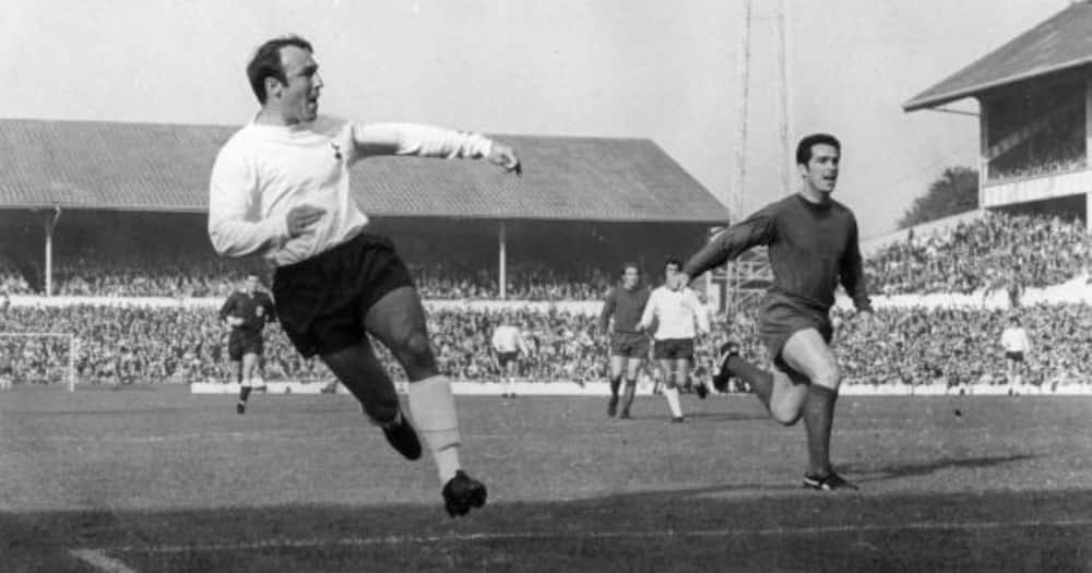 Footballer Jimmy Greaves ( left) of Tottenham Hotspur tries a shot at goal as Spurs play Newcastle United at White Hart Lane. (Photo by Douglas Miller/Keystone/Getty Images)