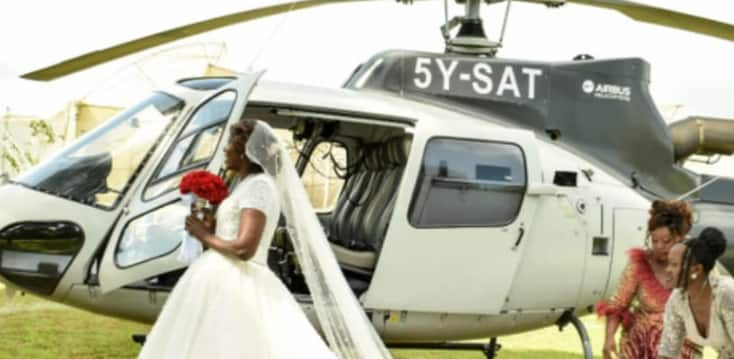 Happy wife remembers hiring chopper for her colouraful white wedding