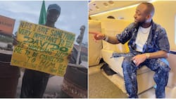 Man Protests with Placard Demanding to Meet Singer Davido, Stirs Massive Reactions Online