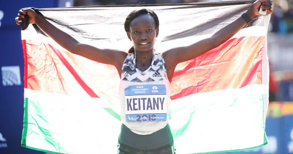 Women's division winner Mary Keitany of Kenya celebrates at the finish line during the 2018 TCS New York City Marathon November 4, 2018 in New York City. (Photo by PhotoRun/New York Road Runners via Getty Images)