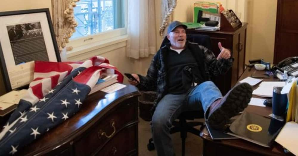Man photographed sitting with foot on desk in Nancy Pelosi's office arrested