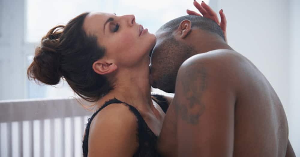 Man kissing woman.