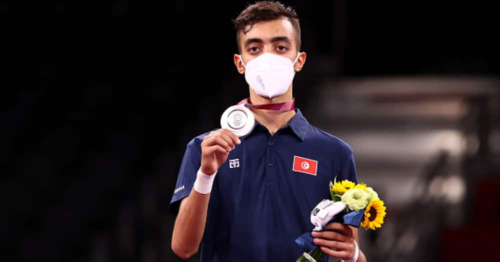 Silver medalist Mohamed Khalil Jendoubi of Team Tunisia poses with the silver medal for the Men's -58kg Taekwondo Gold Medal at Makuhari Messe Hall on July 24, 2021 in Chiba, Japan. Photo by Maja Hitij/Getty Images.