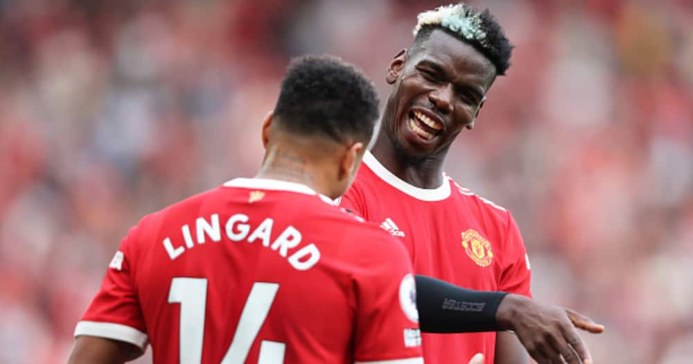 Jesse Lingard celebrates with Paul Pogba after scoring their side's fourth goal during the Premier League match between Manchester United and Newcastle United at Old Trafford. (Photo by Clive Brunskill/Getty Images)
