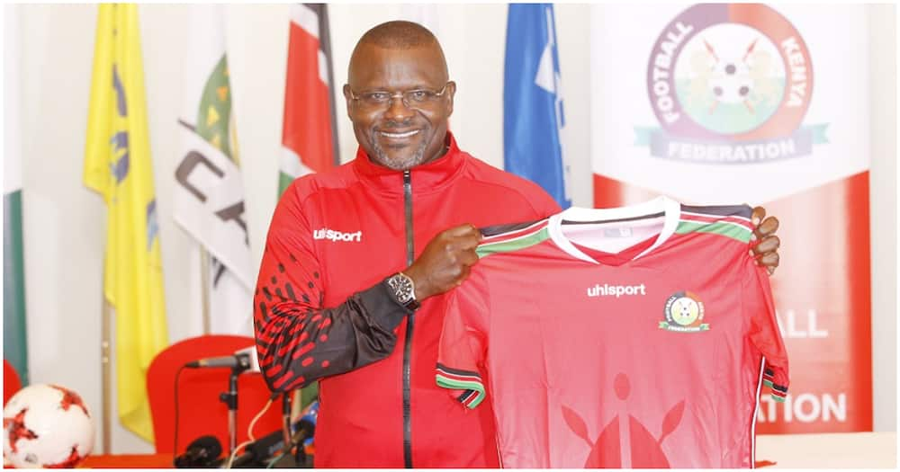Mulee poses with a Harambee Stars shirt after he was appointed as head coach in October 2020. Photo: Twitter/Football Kenya Federation.