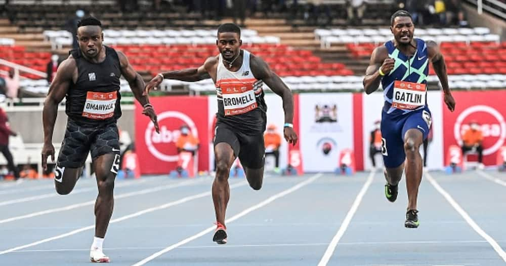 From L to R Kenya's Ferdinand Omanyala, Trayvon Bromell of the US and Justin Gatlin of the US, compete in the men's 100m race of the Kip Keino Classic-World Athletics Continental Tour 2021, at the Kasarani stadium. (Photo by Simon MAINA / AFP)