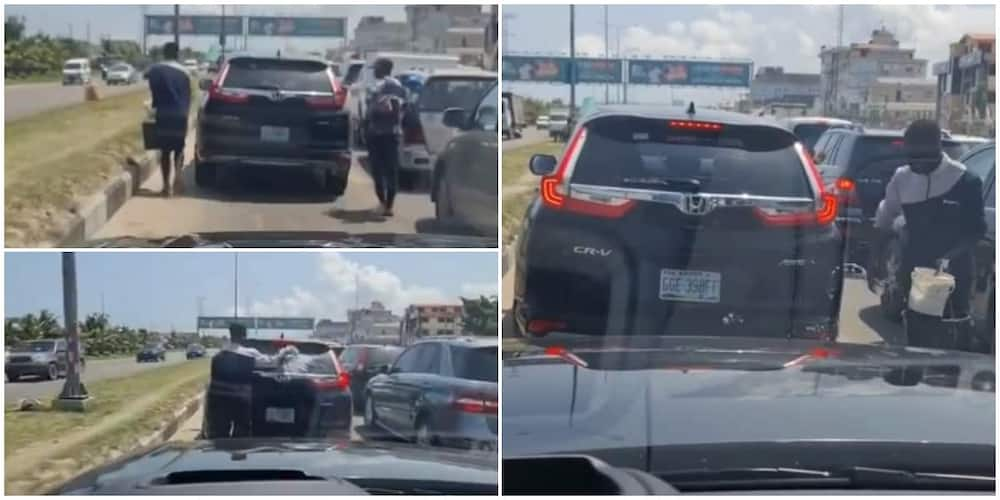 Wetin You no Go See for Lagos: Reactions as 'Hustler' Washes Moving Car on the Road, Video Goes Viral