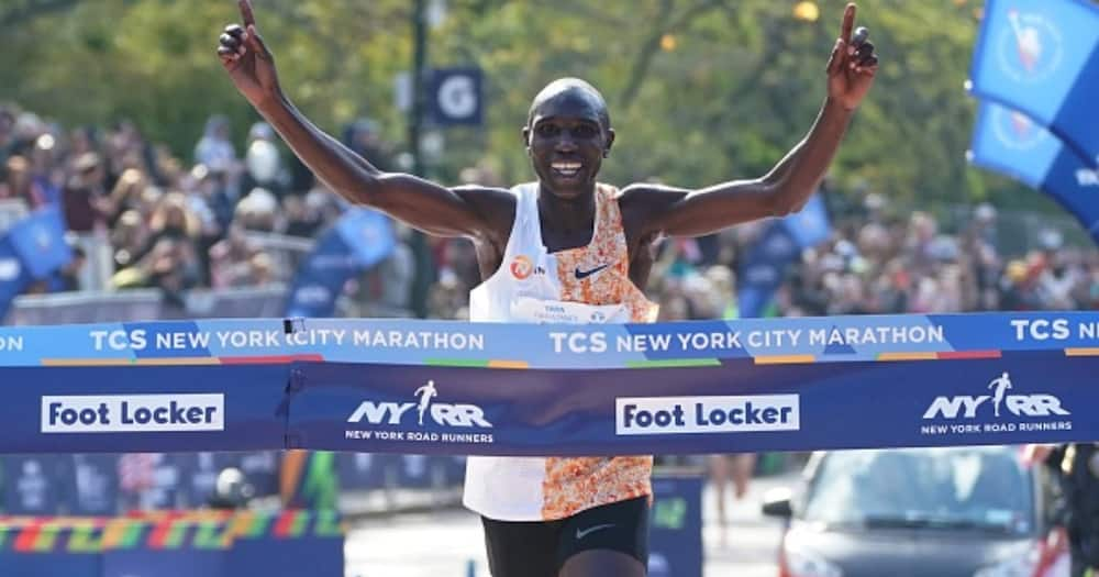 Geoffrey Kamworor of Kenya crosses the finish line to win the Professional Men's Finish during the 2019 TCS New York City Marathon in New York on November 3, 2019. (Photo by TIMOTHY A. CLARY/AFP via Getty Images)