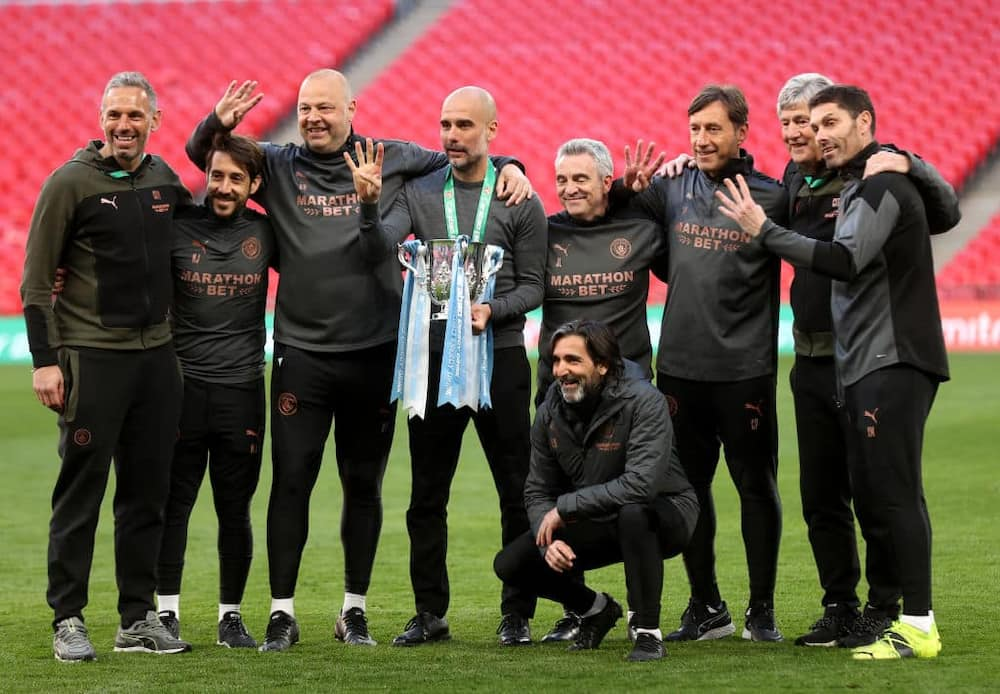 Pep Guardiola and his crew posing with the EFL Cup trophy after their triumph over Tottenham last season. Photo by Clive Rose.