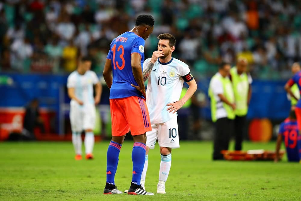 Yerry Mina and Messi.