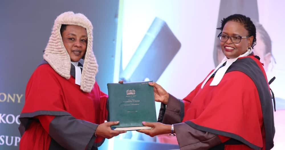 Chief Justice Martha Koome (r) receiving a report of the state of the Judiciary from Deputy Chief Justice Philomena. Photo: The Judiciary.