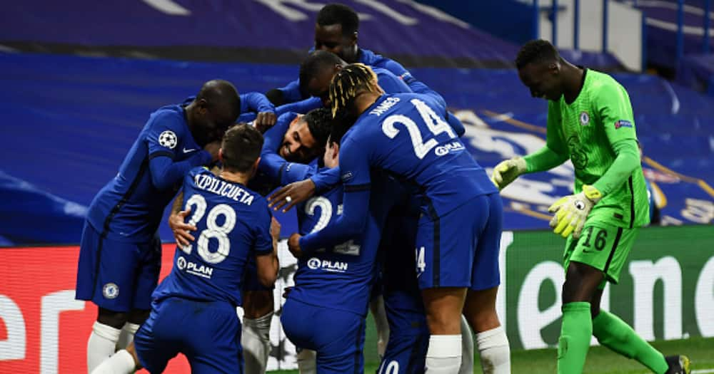 Emerson Palmieri of Chelsea celebrates with teammates after scoring their team's second goal during the UEFA Champions League Round of 16 match between Chelsea FC and Atletico Madrid at Stamford Bridge on March 17, 2021.(Photo by Mike Hewitt/Getty Images)