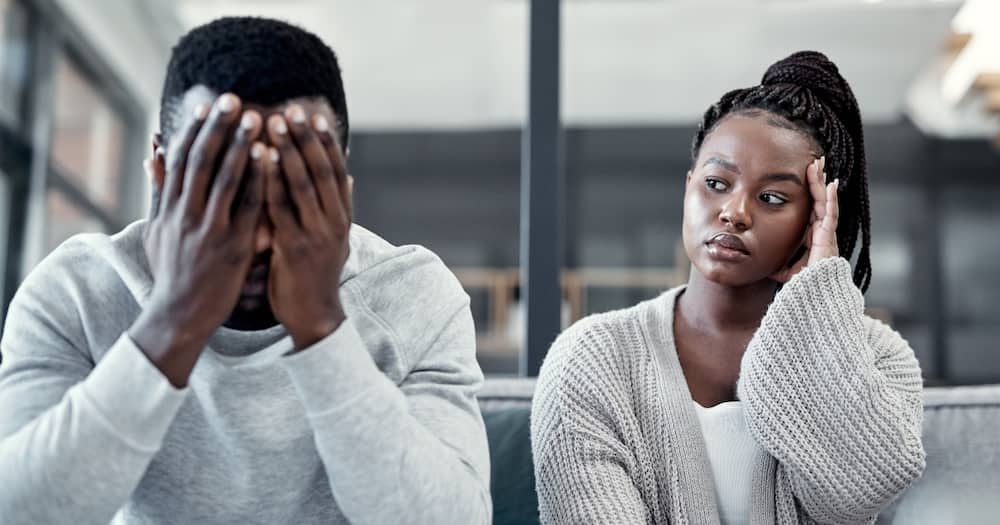 Shot of a young couple ignoring each other after having an argument on the sofa at home. Photo: Getty Images.