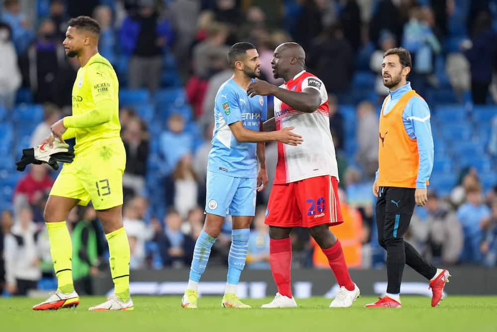 Akinfenwa in action against Man City.
