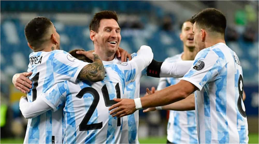 Lionel Messi celebrates with teammates after scoring vs Bolivia - Getty Images.