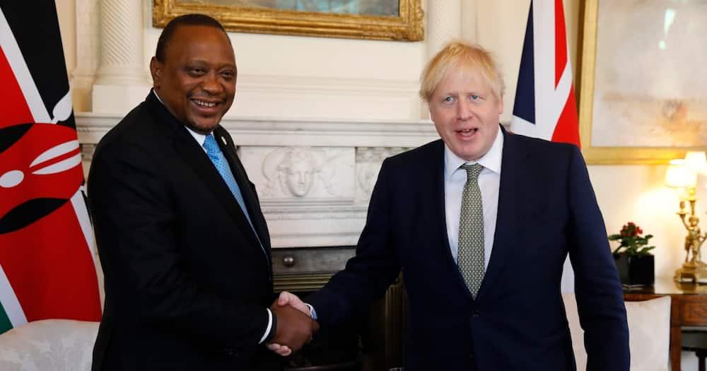 UK Prime Minister Boris Johnson (r) and President Uhuru Kenyatta. Photo: Getty Images.