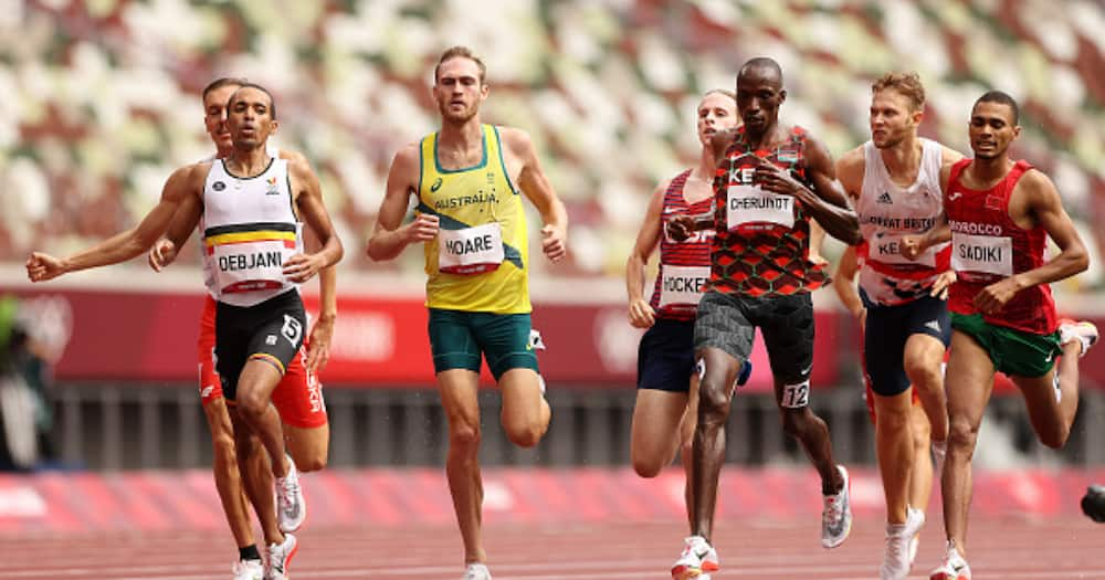 Ismael Debjani of Team Belgium, Timothy Cheruiyot of Team Kenya and Abdelatif Sadiki of Team Morocco compete in round one of the Men's 1500m heats. (Photo by David Ramos/Getty Images)