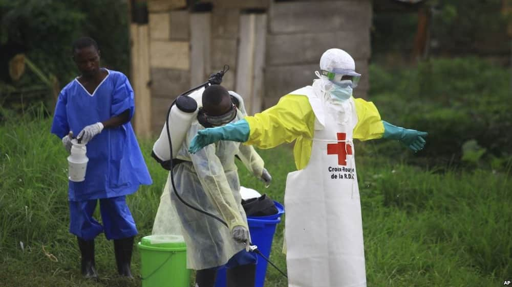 A health worker sprays disinfectant on his colleague during Ebola vaccination exercise in Democratic Republic of Congo.Photo/Citizen