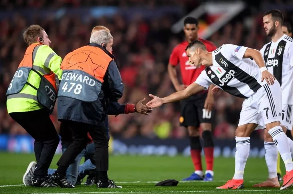 Cristiano Ronaldo gets selfie with a pitch-invading supporter at Old Trafford